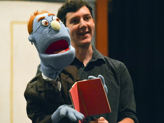 Sam Balzac takes the puppet Rod through rehearsal for