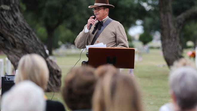 Charles Westbrook, Tom Green County Historical Commission, talks about the history in the cemetery during the Veterans Day Ceremony Friday, Nov. 11, at Fairmount Cemetery.