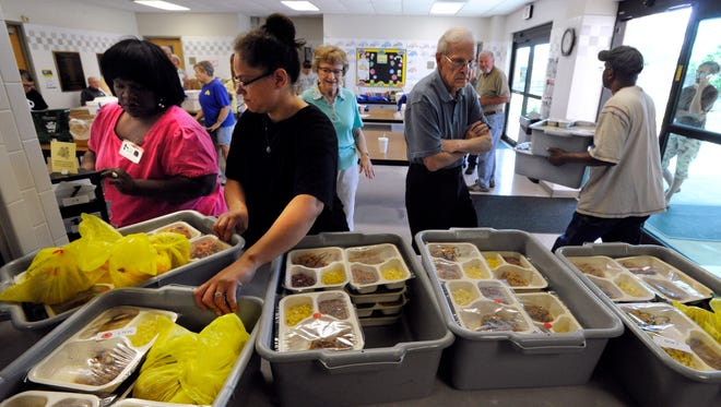 "Volunteer delivery drivers pick out their assigned tubs and take them back to tables to sort them into bags this 2015 file photo. Meals on Wheels is one of a number of local nonprofits who have recently released ""Wish Lists"" 'through the Community Foundation of Abilene."