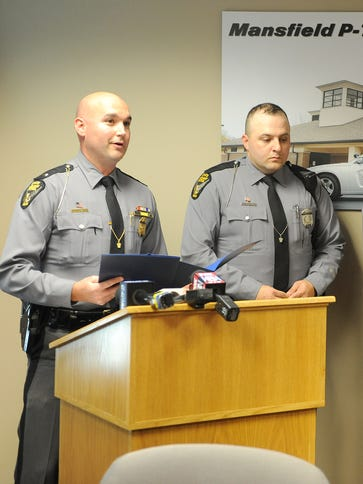 Mansfield post Commander Lt. Matt Them discusses the