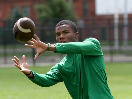 Cass Tech defensive back Kalon Gervin plays catch during