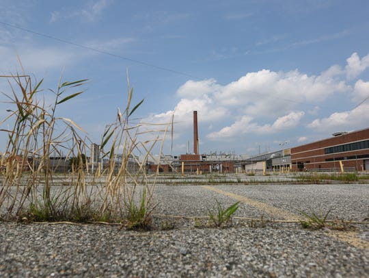 Grass grows in the parking lot of the former 142-acre Fisker Automotive plant, formerly know as the Boxwood plant near Newport. The property was officially purchased by Harvey Hanna & Associates.
