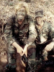 Mary Johnson poses with another paratrooper on the Aviation Officer Basic Course in Alabama in 1987. Johnson went on to be the first woman in the Pathfinder unit.