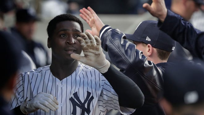 New York Yankees' Didi Gregorius celebrates with teammates in the dugout after hitting a solo home run against the Minnesota Twins during the third inning of a baseball game, Wednesday, April 25, 2018, in New York.