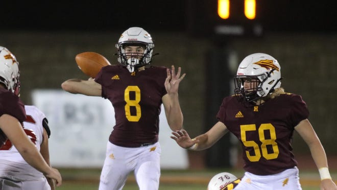 Hays High quarterback Jordan Dale throws a pass during the Indians' 29-6 win over Dodge City last Friday.