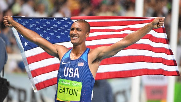 Aug 18, 2016; Rio de Janeiro, Brazil; Ashton Eaton (USA) celebrates winning the men's decathlon event at Estadio Olimpico Joao Havelange during the Rio 2016 Olympic Summer Games. Mandatory Credit: John David Mercer-USA TODAY Sports