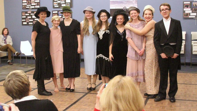 Students and adults model 1920s British garb during Pinckney Public Library's Downton Abbey event held Tuesday evening. From left: Heather Aeschliman, Bella Aeschliman, Emma Aeschliman, Maija Veinbergs, Maggie Uzias, Olivia Menosky, Rachael Menosky, Bonnie Christilaw and Matthew Henning.