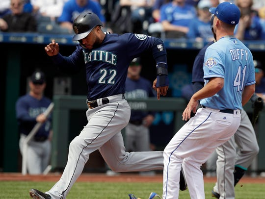 Robinson Cano scores on a wild pitch on Wednesday.