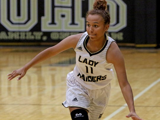 Rider's Tori Williamson dribbles Friday, June 15, 2018,