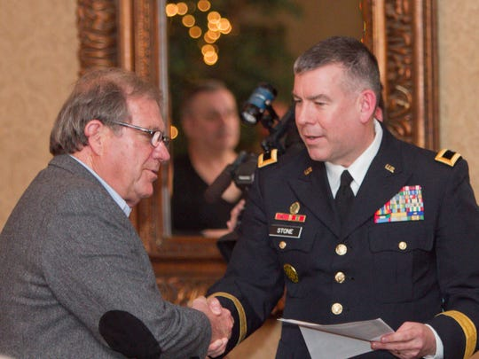 U.S. Army veteran John Colone and over 100 fellow veterans from all branches of the military were honored for their service in the Vietnam War Tuesday afternoon. Michigan National Guard Brig. Gen. Michael Stone acknowledged each veteran with a handshake, followed by the presentation of a commemorative pin by U.S. Rep. Mike Bishop.