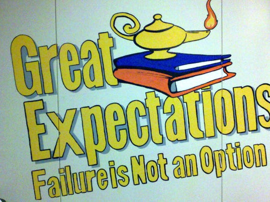 Michael Muldrow, safety and security director for the York City School District, painted this mural on a wall at William Penn Senior High School.