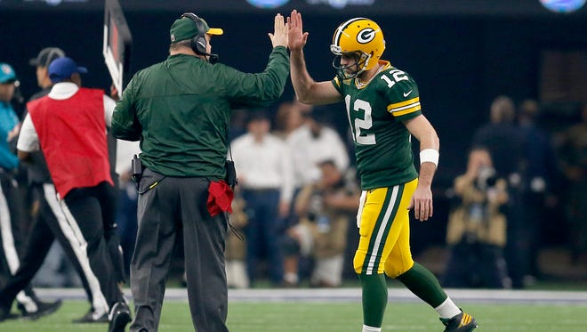 Green Bay Packers quarterback Aaron Rodgers and head coach Mike McCarthy celebrate a touchdown.