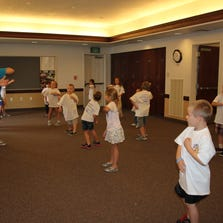 The 5- to 7-year old radKID class practices moves before facing the Red Man Thursday afternoon.
