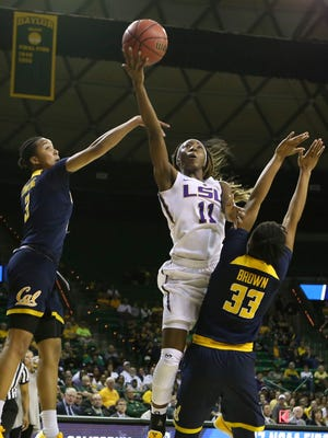 LSU guard Raigyne Moncrief (11) shoots between two California forwards during a game in March. Moncrief was named Player of the Year by the Louisiana Sports Writers Association.