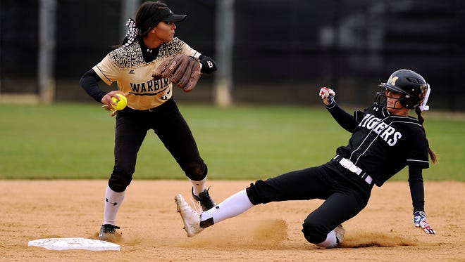 Abilene High shortstop Alyssa Washington (23) turns a double play after forcing out Mansfield High's Reagan Hukill (4) during the top of the second inning of the Lady Eagles' 8-3 loss in the final game of the Region I-6A bi-district playoff on Saturday, April 29, 2017, at Abilene High School.
