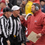 In this Nov. 22 photo, Arkansas head coach Bret Bielema (right) talks to officials in the second quarter the Razorbacks' win over Ole Miss in Fayetteville.