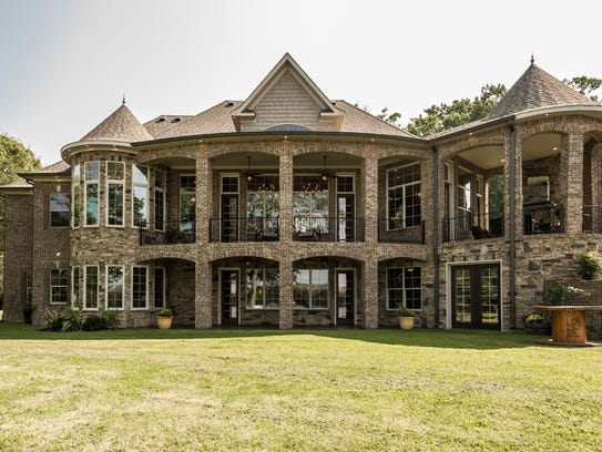 A veranda and multiple porches allow for even greater