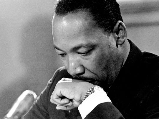Dr. Martin Luther King Jr. appears in deep thought