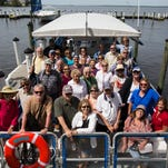 """The News-Press readers sit for a group photo while taking part in the """"Capturing the Caloosahatchee"""" boat excursion with Pure Fort Myers.  The ride included trip with News-Press digital engagement editor, Cory O'Donnell and photographers, Sarah Coward and Andrew West.  Readers get to meet and get tips from the photographers. On this trip they were treated to great views of two bird rookery islands filled with Wood Storks, egrets and the occasional roseate spoonbill."""