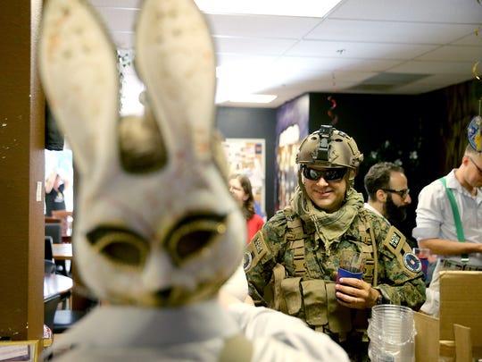 A costumed Danny Pedelaborde of Bremerton orders a
