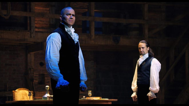 "In this image released by Disney Plus, Chris Jackson portrays George Washington, left, and Lin-Manuel Miranda portrays Alexander Hamilton in a filmed version of the original Broadway production of ""Hamilton."""