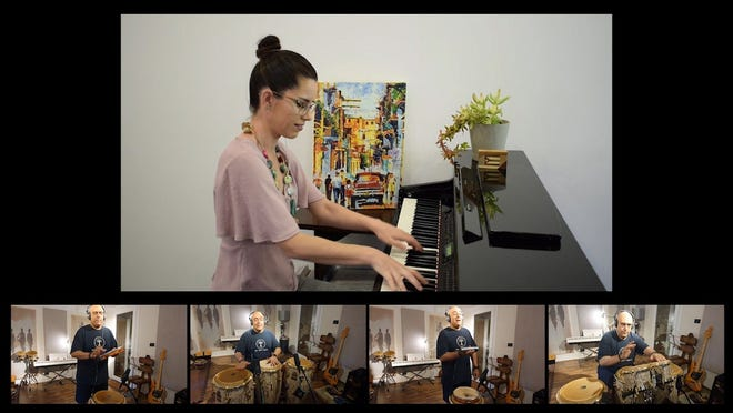 In this image taken from video, pianist Veronica Bievz and percussionist Diaa Badr play the musical accompaniment for a song that was performed by the Cairo Celebration Choir and posted online Aug. 20 in Cairo.