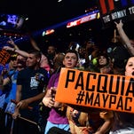 Manny Pacquiao and Floyd Mayweather fans show their support as they await the start of the pre-fight weigh-in on Friday in Las Vegas.