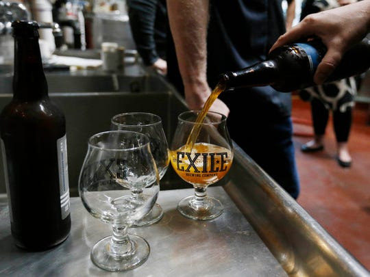Beer makers from around Des Moines sample some of Exile's offerings Wednesday, April 27, 2016, during a visit to the Exile Brewing Company in Des Moines.
