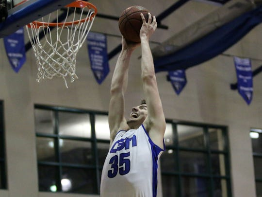 Trent Buttrick pulls back for the dunk during the 5A regional semifinal between CSN and Tampa Catholic at Community School of Naples on Tuesday, Feb. 21, 2017. Tampa Catholic defeated the Seahawks 64-60.
