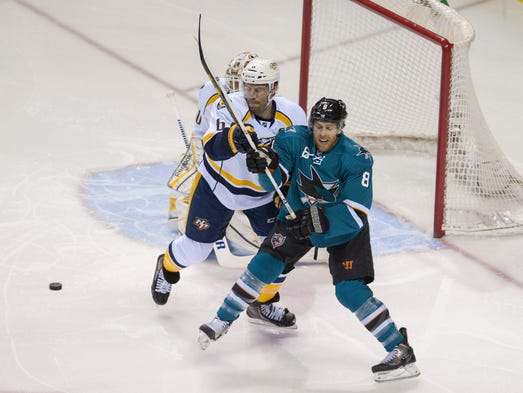 Nashville Predators defenseman Shea Weber (6) battles for the puck with San Jose Sharks center Joe Pavelski (8) during the first period at SAP Center at San Jose.