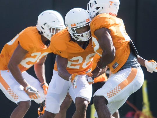 At center Tennessee's Baylen Buchanan participates in a drill during a Vols football practice at University of Tennessee Tuesday, April 3, 2018.