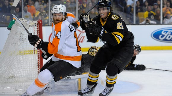Sean Couturier and the Flyers open the season against Loui Eriksson and the Boston Bruins.