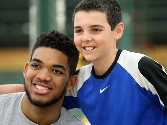 Karl-Anthony Towns poses for a photo with 12-year-old Tommy Armstrong of Clark, Sunday, May 3, 2015, at his alma-mater, St. Joseph of Metuchen.
