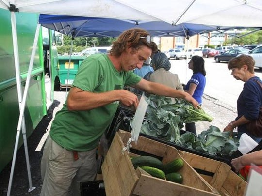 The Good Food Collective sets up for a CSA distribution in 2013.
