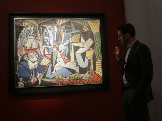 """A Christie's employee speaks about Pablo Picasso's """"Les femmes d'Alger (Version """"O""""), during a media preview on May 1, at Christie's in New York."""