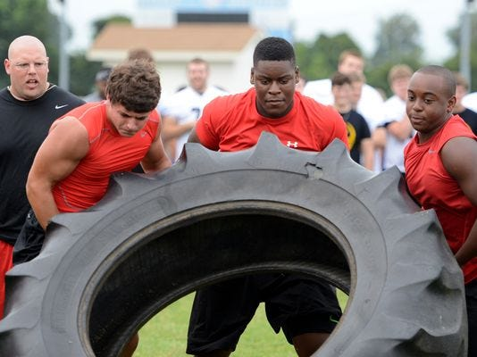 Trey Smith, seen here during a lineman competition at the FCA 7-on-7 camp at USJ last summer, has offers from about a dozen FBS teams to play college football.