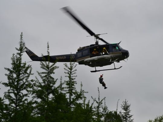 "The New York State Police uses its ""Huey"" helicopter"