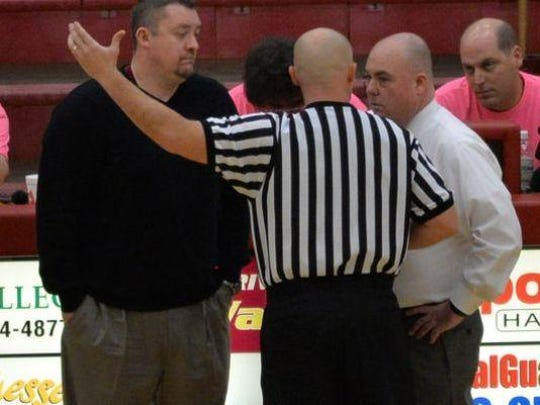 Riverdale coach Cory Barrett, left, and Smyrna's Shawn Middleton were involved in a Feb. 22 game in which both teams tried to lose.