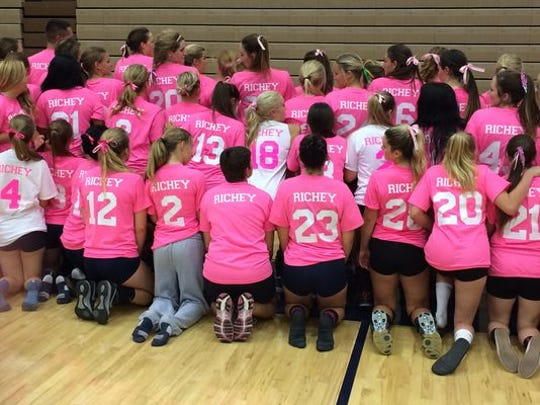 Members of the Snow Canyon and Hurricane volleyball teams show their support for Warrior freshman Mallory Richey who lost her mother to breast cancer last year.