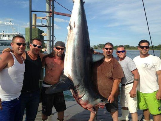 The crew of Fin-Ominal with the 466.8-pound mako shark that won the Brett Bailey Mako Rodeo and Warriors For Warriors charity shark tournaments on Saturday.