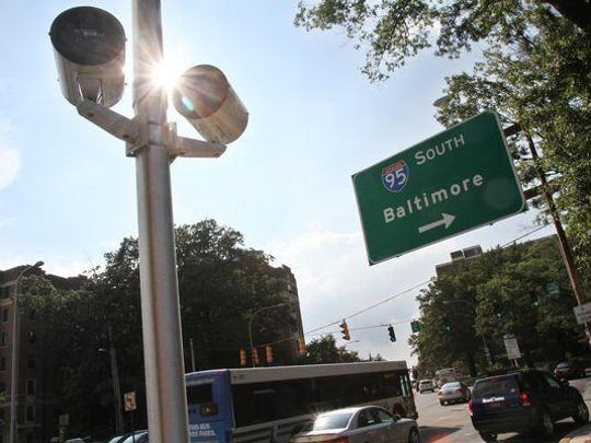 A car turns onto North Van Buren Street in Wilmington, where a red-light camera monitors the junction with Delaware Avenue. Few challenges to these citations are ever successful.