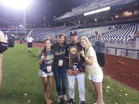 Vanderbilt baseball coach Tim Corbin with his wife, Maggie, center, and her daughters, Molly Blatt, left, and Hannah Blatt.