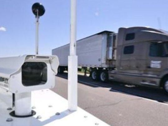 A semi-tractor trailer passes a traffic camera along Interstate 29 in Sioux City.