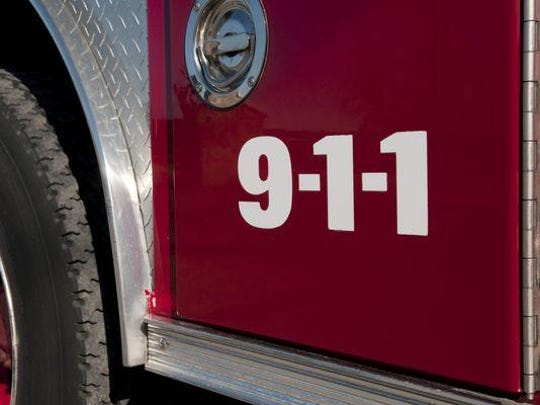 A passerby pulled an unconscious man from a burning vehicle after it went out of control on Route 37 Saturday and struck a sign, some shrubs and a fence, police said.