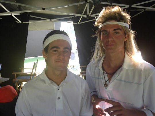 """Palm Desert High School graduates Cameron McDonald, left, and Connor Berk donned wigs to look like actors Kit Harington and Andy Samberg. They played stand-ins for the two actors in the movie """"7 Days in Hell"""" which debuts Saturday on HBO."""