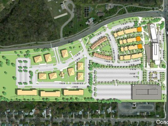 A conceptual drawing of the new $156.7 million Spartan Village complex at the corner of Harrison Road and Kalamazoo Street at Michigan State University. Officials say it should be complete by late 2017.