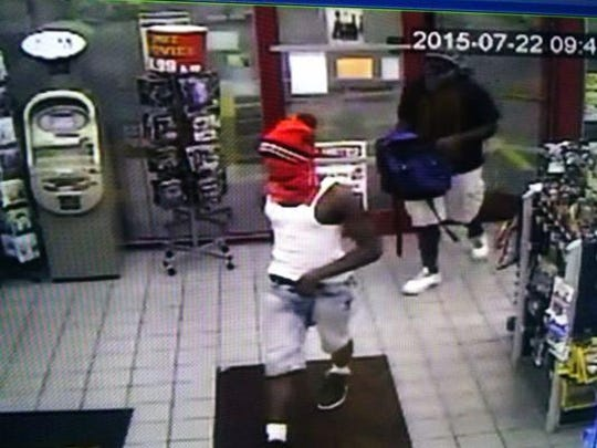 Jackson police are searching for two men accused of robbing a Bowling Drive gas station Wednesday night.