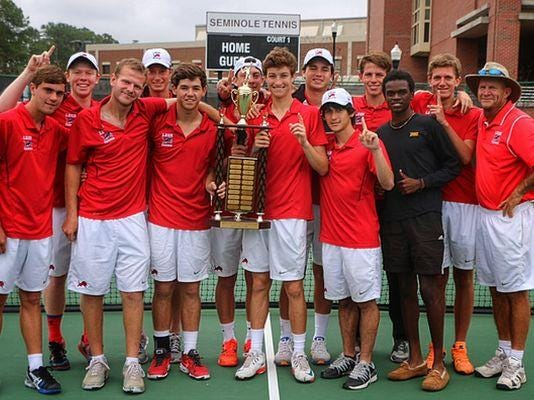 The Leon boys tennis team and head coach Kevin Record (far right) celebrate a 2015 city title at FSU's tennis complex.