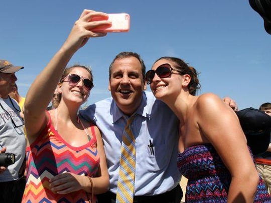 Gov. Chris Christie takes a selfie with sisters, Rachel and Katie DiPalo of Wayne, before a press conference in Belmar, NJ