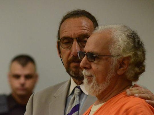 Mario Barroso stands with his attorney, Seymour Schwartz, in court on Tuesday. Barroso pleaded no contest to a manslaughter charge in the Jan. 1, 2012, death of Leeroy Taylor at the Iron Coffins Motorcycle Club house on Gilbert Street.
